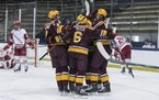 Gophers players celebrated after scoring against Wisconsin on their way to winning the 2021 Big Ten tournament championship.