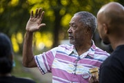 Former City Council Member Don Samuels, seen at a neighborhood event on Aug. 12, is one of three Minneapolis residents behind the lawsuit.
