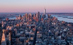 The Manhattan skyline is seen at sunrise from the 86th floor observatory of the Empire State Building on April 3 in New York City.