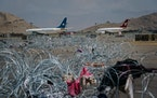 Barbed wires lay across the tarmac at Hamid Karzai International Airport in Kabul, Afghanistan, on Aug. 31, left behind after the United States milita