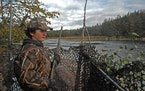 Parker Smith, a Willmar eighth-grader, overlooks a Minnesota River backwater in Renville County on the first day of duck hunting Saturday. Hunting gen