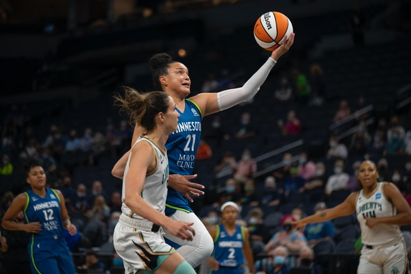 Lynx guard Kayla McBride shot while outrunning the defense of New York Liberty guard Rebecca Allen in the first quarter.
