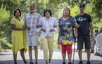 Sondra and Don Samuels, at left, stood alongside Cathy Spann, Audua Pugh and Michael Pugh in the Jordan neighborhood of Minneapolis in July.