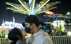 Faith Vang of East St. Paul kissed boyfriend Jayson Sanchez of Richfield as they waited to ride the Sky Flyer at the Minnesota State Fair's Mighty M