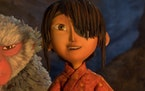 """Laika Studios/Focus Features  Monkey, voiced by Charlize Theron, and Kubo, voiced by Art Parkinson, in """"Kubo and the Two Strings.""""   via AP"""