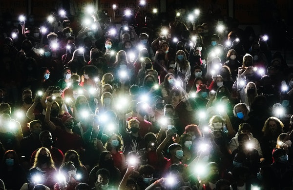 Apple Valley High underclassmen illuminated the darkness with cell phone flashlights as a video of Gable Steveson's Olympic highlights played on a s