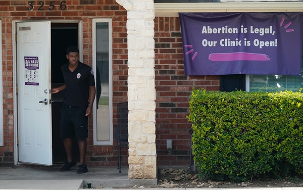 A security guard opened the door on Wednesday to the Whole Women's Health Clinic in Fort Worth, Texas.