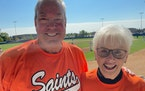 Dick Bremer with Darlys Forcier, his fourth grade teacher in Dumont, Minn. They were supporting Dumont Saints on Saturday in Waconia in the state amat
