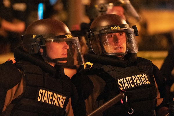 Minnesota State Patrol officers stood watch outside of the Third Precinct station in May 2020.