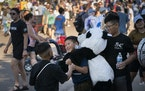 From left; Poseidon Thao, 8, Chance Yang, 9, and Evann Gonzalez, 10, used a giant panda toy to roughhouse as they enjoyed the State Fair with friends