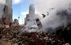 Fires still burned amid the rubble of the World Trade Center on Sept. 13, 2001, days after the terrorist attack.