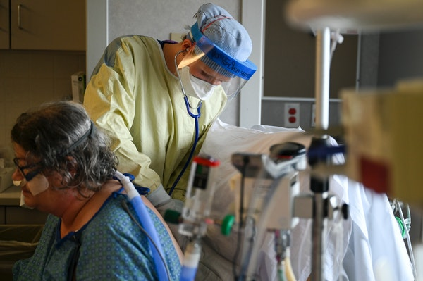 North Memorial critical care nurse Monica Lindblad worked with COVID-19 patient Melody Biggar, of Robbinsdale, on Thursday, Sept. 3, 2020 in Robbinsda