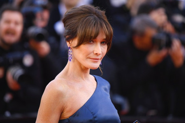"""Former model Carla Bruni-Sarkozy poses for photographers upon arrival at the premiere of the film """"Les Miserables"""" at the 72nd international film"""
