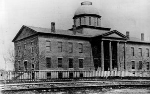 St. Paul as photographed in the 1850s. The Territorial Legislature met in the state's first capitol, the domed building in the background.
