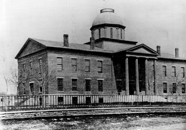 The first capitol building in Minnesota was this structure erected in 1853 at what is now the corner of Tenth and Wabasha streets. First occupied on J