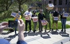 Activists posed in April with signed petitions calling for replacing the Minneapolis Police Department with a new Department of Public Safety; for eli
