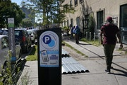 Foes say parking meters near Karmel Mall are bad for business and the neighborhood.