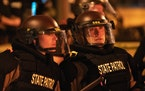Minnesota State Patrol officers stood watch outside of the Third Precinct in Minneapolis on May 28, 2020.