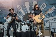 Scott Avett, left, and Seth Avett are hoping to return to the stage next week.