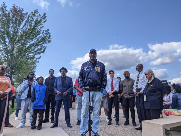 Longtime community organizer Al Flowers addressed reporters during a Thursday afternoon vigil  for 12-year-old London Bean, who was gunned down during