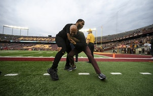 Olympic wrestler gable Steve wrestled with Gophers football coach P.J. Fleck when Steveson attended the game against Ohio State last week..