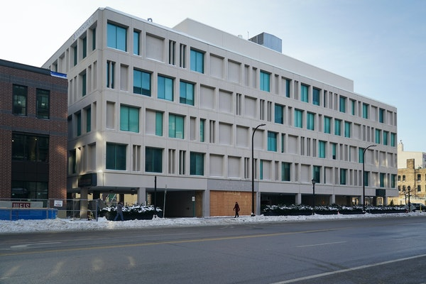 A 27-story apartment building will replace this structure on Washington Avenue N. in Minneapolis.