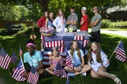 Operators of the Eden Prairie lemonade stand which has donated money to charities since 9/11 stood for a portrait with a mockup of the stand Saturday