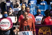JaNaé Bates, with Yes for Minneapolis, spoke at a podium outside City Hall on Friday as she stood with representatives from different unions who came