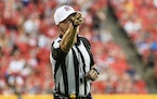 ShawnHochuli, the referee during Thursday's season opener between Tampa Bay and Dallas, makes a call during the first half of a preseason game bet