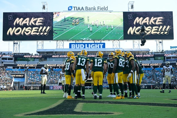 Green Bay Packers quarterback Aaron Rodgers (12) huddles with the team during the second half of an NFL football game against the New Orleans Saints,