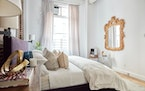 A gold mirror and gold accessories add a pop of metallic to this master bedroom.