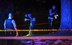 The Minneapolis Police Department's crime lab unit investigated the scene of a shooting in north Minneapolis in August 2020 in which multiple people