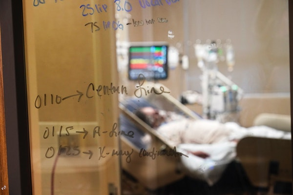 Medical notations are written on a window of a COVID-19 patient's room in an intensive care unit at the Willis-Knighton Medical Center in Shreveport