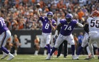 Minnesota Vikings quarterback Kirk Cousins (8) and offensive lineman Olisaemeka Udoh (74).