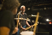 Bob Mould and drummer Jon Wurster, shown here rehearsing in 7th Street Entry in 2014. return to the road Thursday.