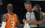 Referee Scott Foster talks with Phoenix Suns guard Chris Paul (3) before the start of Game 6 of basketball's NBA Finals against the Milwaukee Bucks