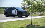 A Sartell Police Department squad has a 'Thin Blue Line' flag decal on a rear window. (Credit: Jenny Berg)