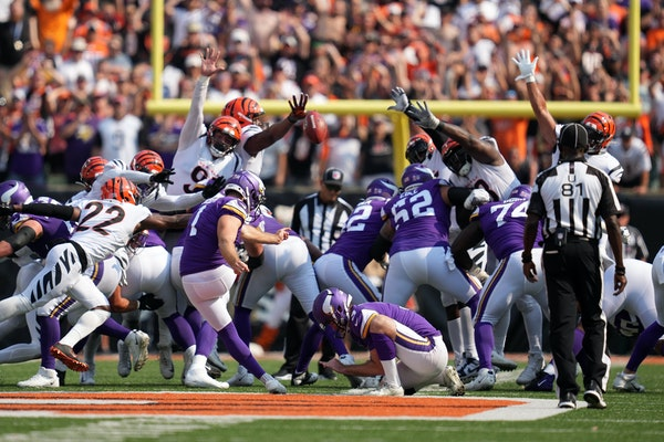 Minnesota Vikings kicker Greg Joseph (1) kicked a tying field goal to send the game into overtime at the end of the fourth quarter.