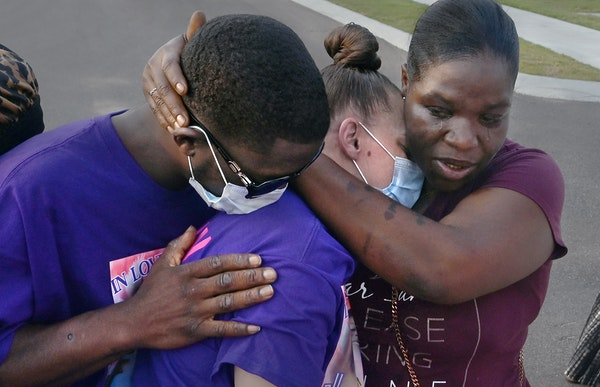 Ricky Franklin and his wife, Caylenn Franklin, center, are comforted by Anglea Jackson on Aug. 6 in West Memphis, Ark. The Franklins' 11-year-old da