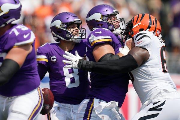 Vikings center Garrett Bradbury tried to keep Bengals defensive tackle Larry Ogunjobi away from Kirk Cousins on Sunday.