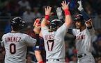 Cleveland Indians shortstop Andres Gimenez (0), catcher Austin Hedges (17) and left fielder Oscar Mercado (35) celebrated Mercado's three-run home r