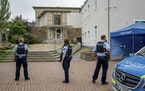 Police officers at the entrance to the Jewish Community building in Hagen, Germany, Tursday, Sept. 16, 2021.