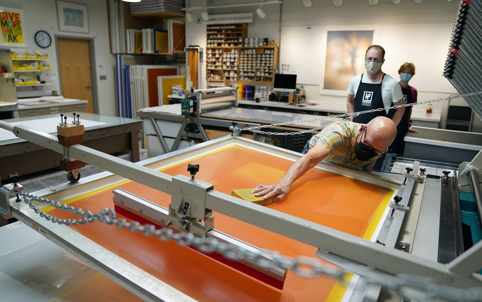 Cole Rogers, who founded Highpoint Center for Printmaking with Carla McGrath, worked on the proofing process for a screen print by artist Julie Mehret