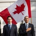 President Barack Obama and Canadian Prime Minister Justin Trudeau, stand for the playing of national anthems during an arrival ceremony on the South L