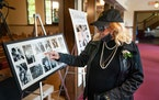 Sharon Nelson, sister of John Nelson, and Prince�s sister, looked over photo tributes to her late brother John at his funeral service.