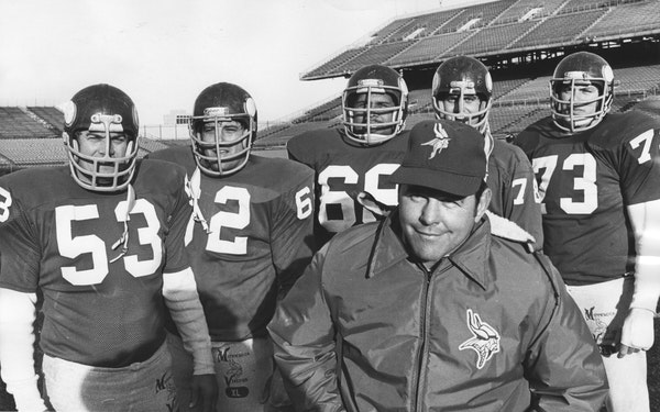 Steve Riley, second from right, was part of a Vikings offensive line coached by John Michels, front, in 1976. From left, Mick Tingelhoff, Ed White, Ch