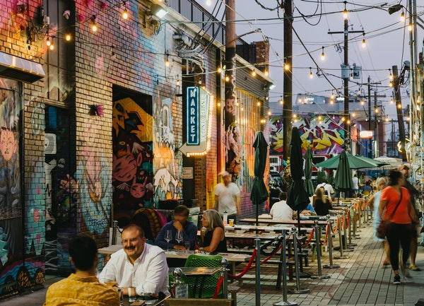 Patrons dine in an alleyway in RiNo, a mural-covered arts district made up of portions of five neighborhoods in north Denver.