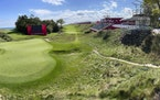 Temporary grandstands were set up around the 18th hole at Whistling Straits Golf Course in Haven, Wis., on Tuesday in preparation for the Ryder Cup.