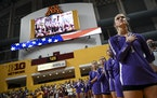 The St. Thomas volleyball team, including middle blocker Ellie Dammann (1), stood for the national anthem before Thursday night's match against the