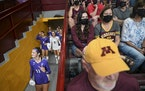 The St. Thomas Tommies, including right side hitter Claire Ricard (11), walked out the tunnel before their match against the University of Minnesota G